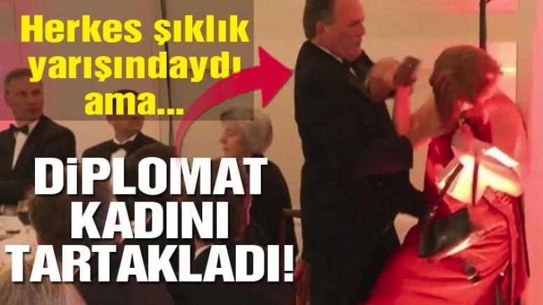 Diplomat davette protestocu kadını yaka paça tartakladı